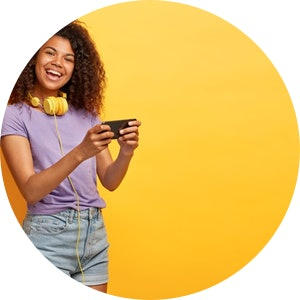 Half length shot positive young female with afro hairstyle posing against yellow wall 273609 31542.jpg?ixlib=rails 1.1